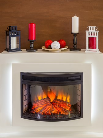 white electric fireplace with a fire and surrounding decorations