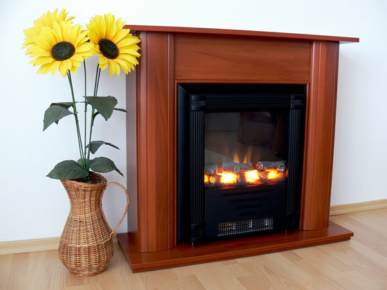 decorative electric fireplace with a basket of sunflowers